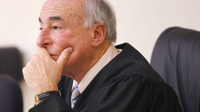 A fole of photo of Judge Mark Coven listening to charges against  a defendant in Quincy District Courti on Monday, Feb. 5, 2018. Greg Derr/ The Patriot Ledger