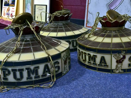 In the liquidation sale at Saint Joseph's College, the school has set aside memorabilia, including these light fixtures, that will be auctioned off to alumni during September.