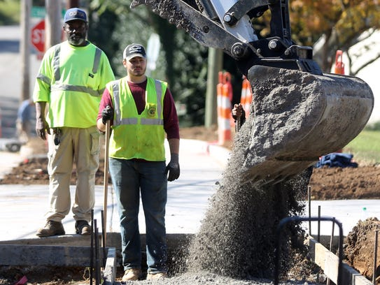Workers add a sidewalk to Franklin Avenue between Manchester