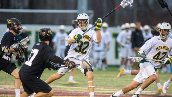 The University of Vermont's Andrew Simeon passes the ball against UMBC in Burlington on Friday April 27, 2018.
