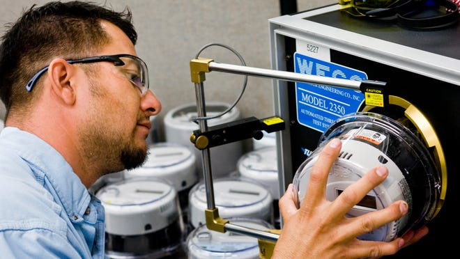 A technician tests a smart meter at the Arizona Public Service Co. meter shop in Phoenix in 2010.