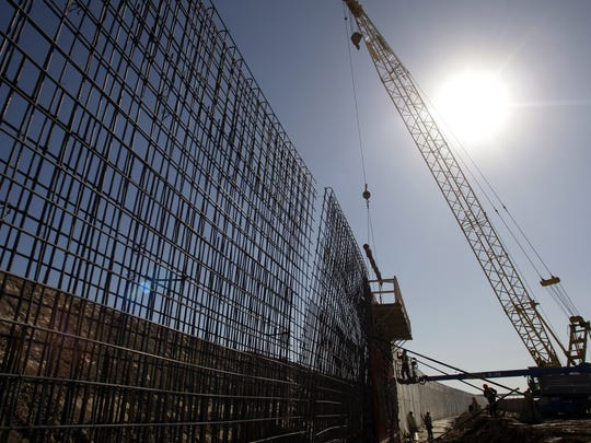 The sun beats down on construction workers building the border wall in Granjeno, Texas, in 2009.