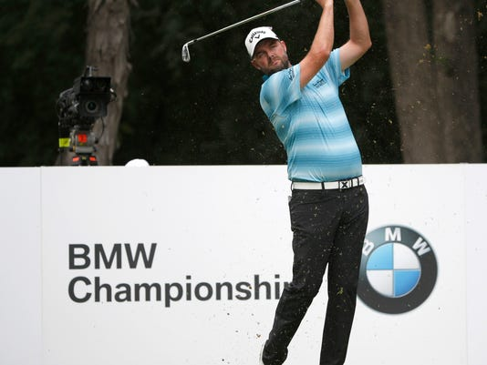 Marc Leishman watches his tee shot on the second hole during the final round of the BMW Championship golf tournament at Conway Farms Golf Club, Sunday, Sept. 17, 2017, in Lake Forest, Ill. (AP Photo/Charles Rex Arbogast)