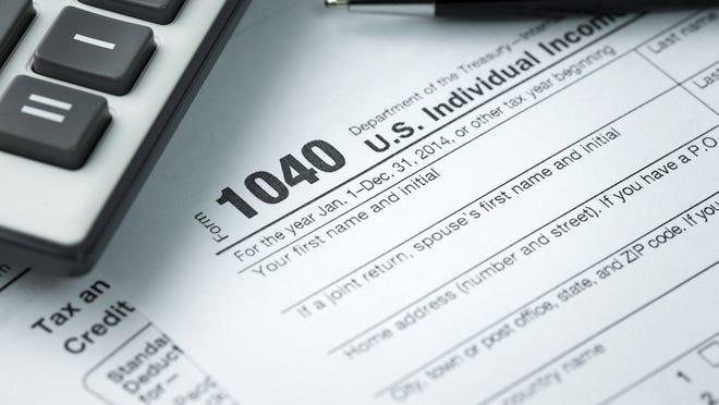 Tax return next to a calculator