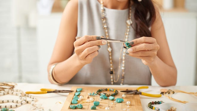 An artisan makes handmade jewelry.