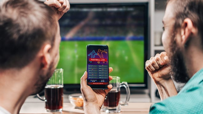People betting on sports on a mobile device.