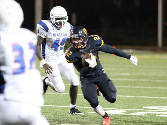 Naples runningback Antonio Carbonaro runs for the first down during the Golden Eagles' game against Hialeah Friday night.