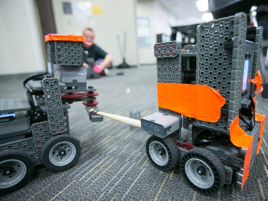 Students work on robots during a robotics class at Cooley Middle School in Gilbert on Tuesday, September 23, 2014.