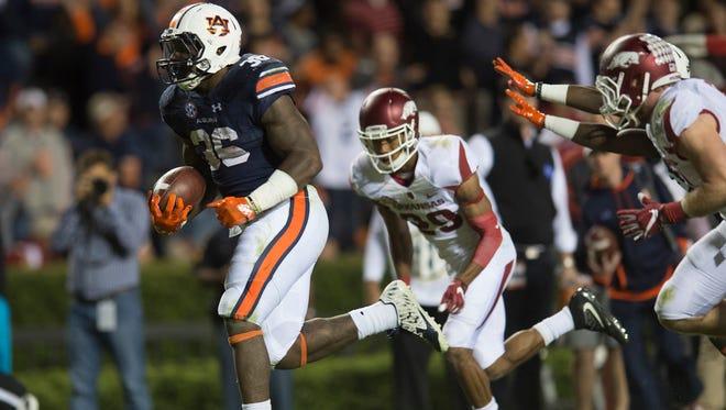 Auburn running back Kamryn Pettway (36) scores a touchdown during the NCAA football game between Auburn and Arkansas Saturday, Oct. 22, 2016, in Auburn, Ala. Auburn defeated Arkansas 56-3.