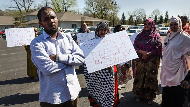 Parent Mohamed Jama joined other parents outside the St. Cloud Math and Science Academy charter school Monday, May 7, in a protest against school management.