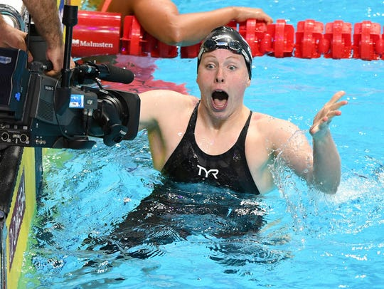 Lilly King of the USA celebrates her world record and