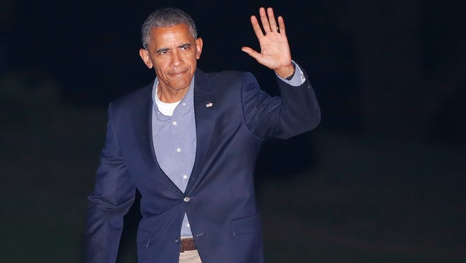 President Barack Obama waves to members of the media as he walks across the South Lawn of the White House in Washington, Friday, Sept. 9, 2016, during his return from nearby Andrews Air Force Base. Obama traveled to Asia this week and was returning from Laos after attending the ASEAN Summit.