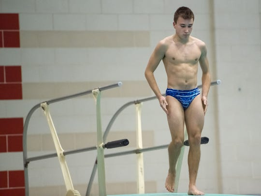 Chambersburg's Nick Cover take his place on the diving board during the AAA diving championship at Cumberland Valley High School on Wednesday, Feb. 8, 2017.