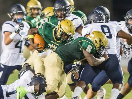 Acadiana's Jaylen James (2) runs for a first down as