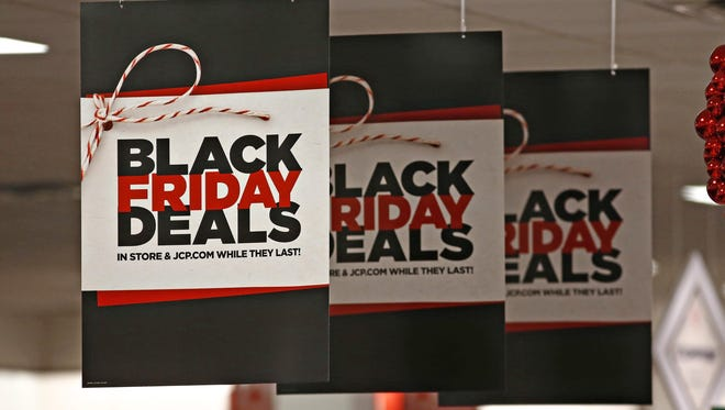 Signs in the JC Penny in the Arrowhead Mall in Glendale on Black Friday, November 27, 2015.