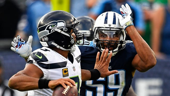 Seahawks quarterback Russell Wilson (3) faces pressure by the Titans' Wesley Woodyard (59) in the second half Sunday, Sept. 24, 2017, at Nissan Stadium.