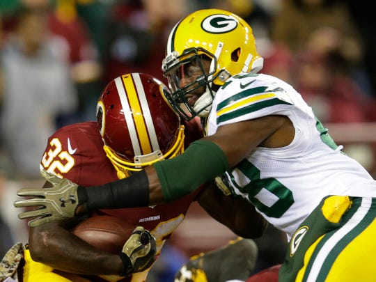 Green Bay Packers linebacker Joe Thomas tackles Washington running back Rob Kelley (32) for a loss during the first quarter at FedEx Field.