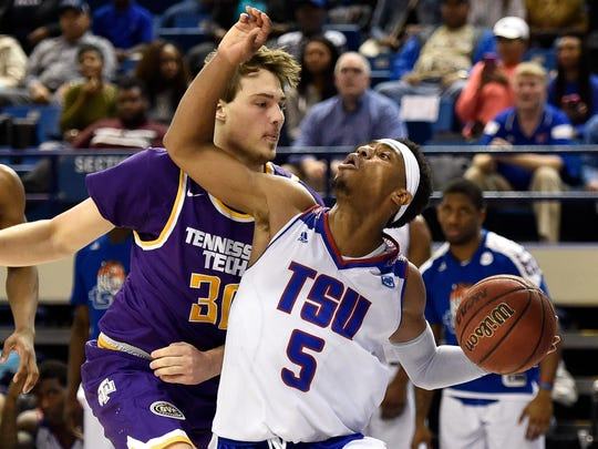 Tennessee State Tigers guard Tahjere McCall (5) is guarded by Tennessee Tech Golden Eagles forward Colton Blevins (30) during overtime at the Gentry Center in Nashville, Tenn., Thursday, Jan. 19, 2017.