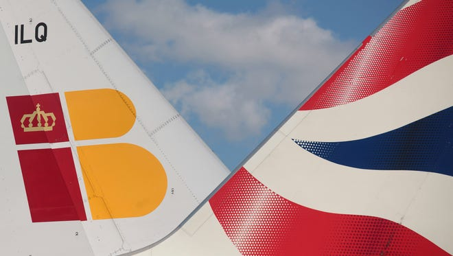 This file image shows the tails of a British Airways plane and an Iberia plane.