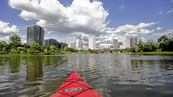 Columbus' downtown skyline is visible from a kayak on the Olentangy River near the confluence with the Scioto River on June 25.