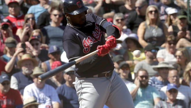 The Indians' Franmil Reyes hits during the second inning of a spring training  game in March.