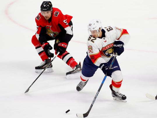 Ottawa Senators defenseman Cody Ceci (5) tries to get the puck from Florida Panthers center Denis Malgin (62) during the first period of an NHL hockey game Thursday, March 29, 2018, in Ottawa, Ontario. (Patrick Doyle/The Canadian Press via AP)