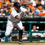 Detroit Tigers catcher Bryan Holaday hits a sacrifice bunt in the eighth inning against the Chicago White Sox at Comerica Park. Detroit won 6-1.