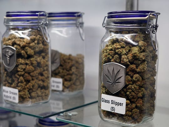Glass jars of marijuana offered for sale at the Medicine Man cannabis dispensary in Denver.