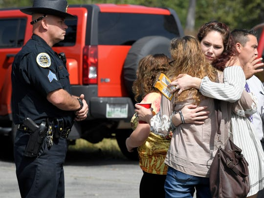 People hug outside Burnette Chapel Church of Christ