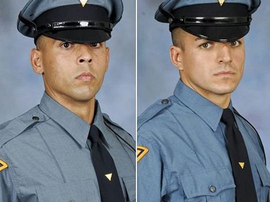 Troopers Adam Gonzalez and Justin Storie rescued a woman from a Mount Olive home Tuesday evening.