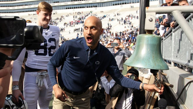 American actor Keegan-Michael Key rings the victory bell after the conclusion of the Blue-White spring game.