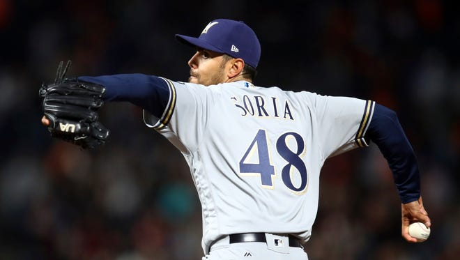 New Brewers pitcher Joakim Soria pitches the seventh inning.