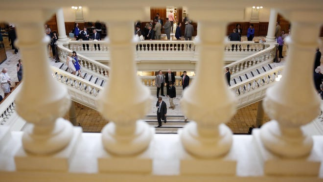 Lobbyists and lawmakers mingle in the south atrium of the Georgia Capitol.