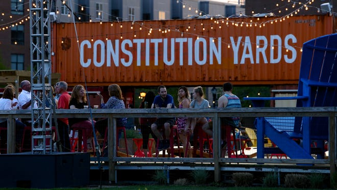 Dusk falls over the Constitution Yards beer garden in Wilmington's Riverfront section.