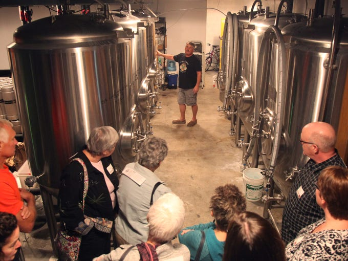 Chris Hart, of the Cape Coral Brewing Company, gives
