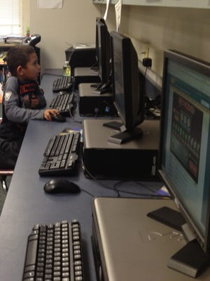 A youngster uses a computer at Starr school during an activity.
