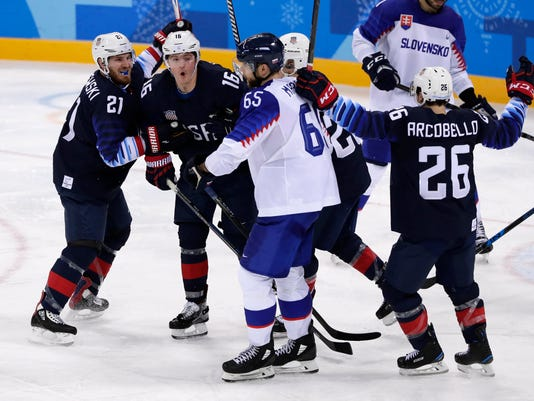 Ryan Donato (16), of the United States, celebrates his goal with James Wisniewski (21) and other teammates during the third period of the preliminary round of the men's hockey game against Slovakia at the 2018 Winter Olympics in Gangneung, South Korea, Friday, Feb. 16, 2018. (AP Photo/Frank Franklin II)