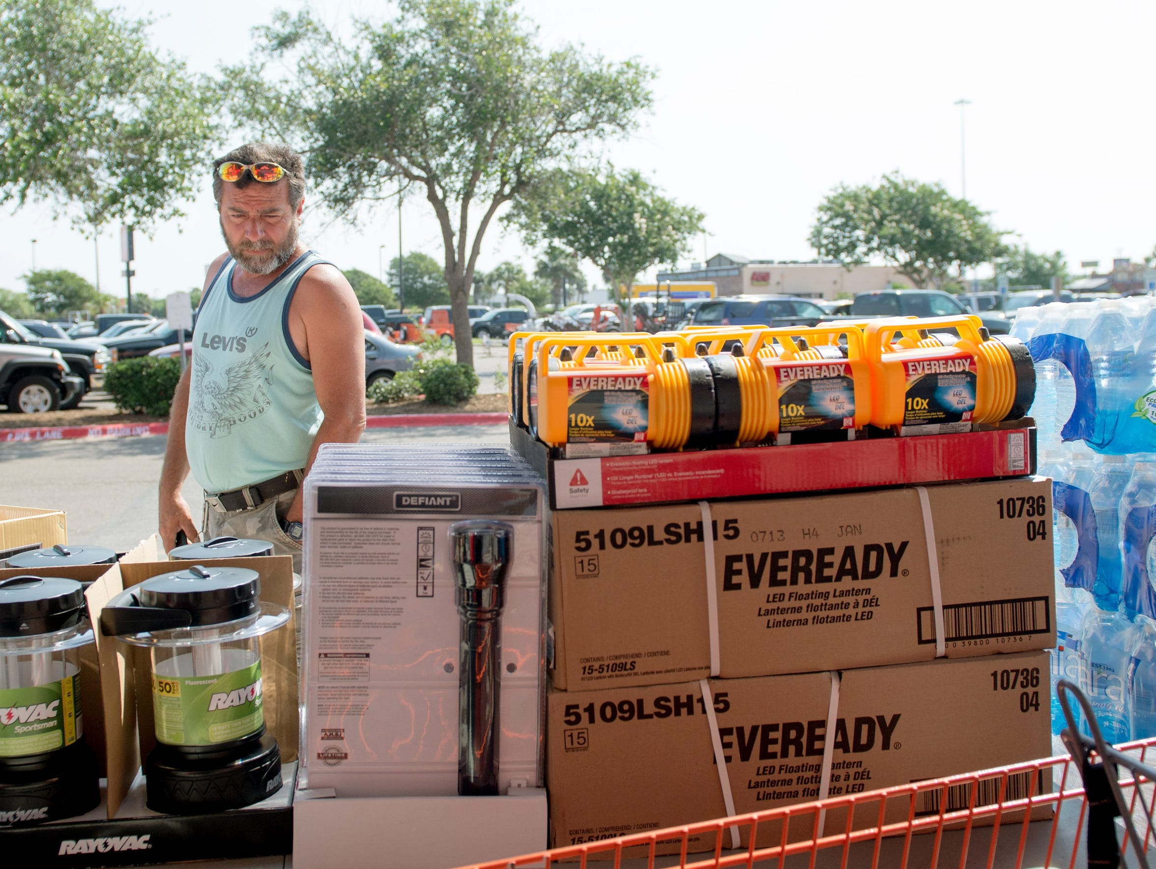 Batazar Martinez views the supplies Home Depot set