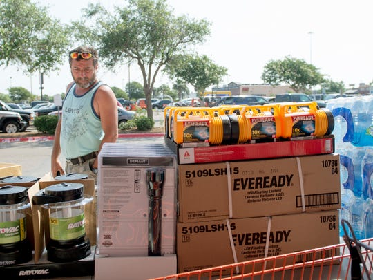 Batazar Martinez views the supplies Home Depot set out as hurricane safety essentials on Saturday, May 31, 2014, for a  hurricane workshop.