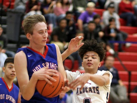 Freshman Wildcat Nathan Arroyo (4) battled Tigers'