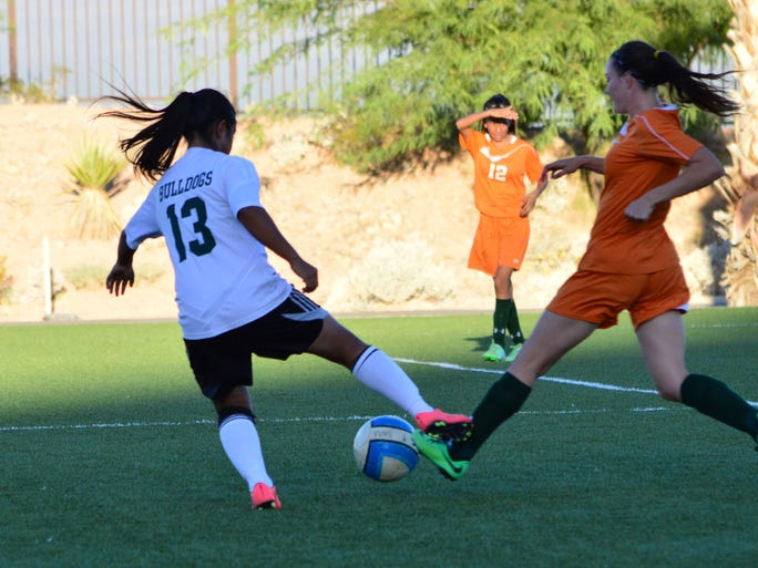 Marlene Quirarte battles a Mojave player for the ball.