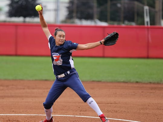 Beijing Shougang Eagles pitcher Wang Lan winds up to throw, during during a recent game, against the Akron Racers.