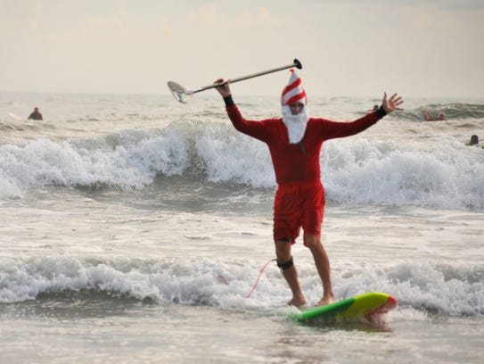 Last Christmas Eve, Surfing Santas drew772 costumed surfers to Cocoa Beach.
