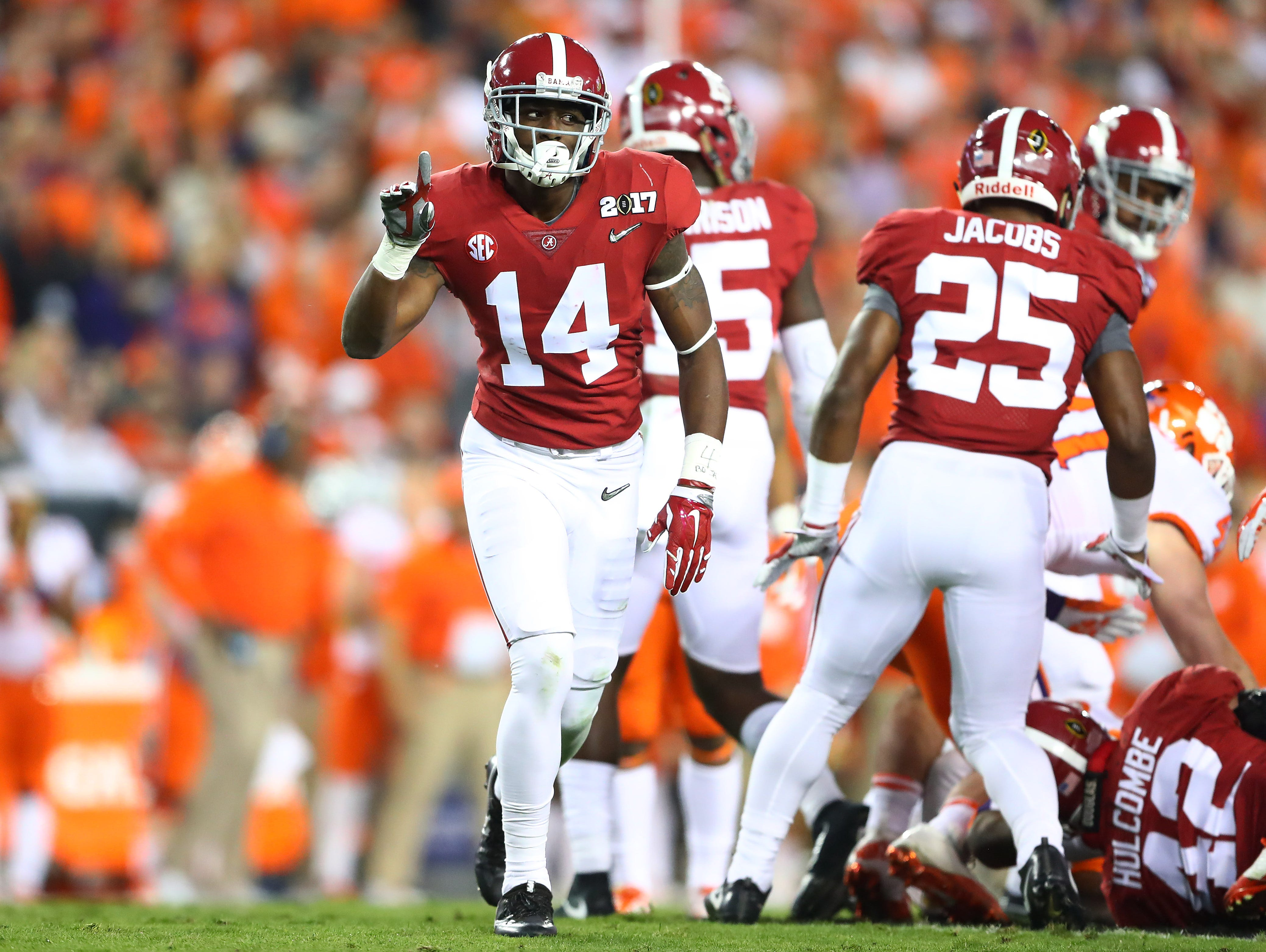 Alabama Crimson Tide defensive back Deionte Thompson (14) reacts after a play during the second quarter against the Clemson Tigers in last season's national championship game.