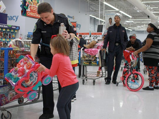 The lines get long as children line up with local officers to pay at the Shop with a Cop event in Gallatin on Dec. 2, 2017.