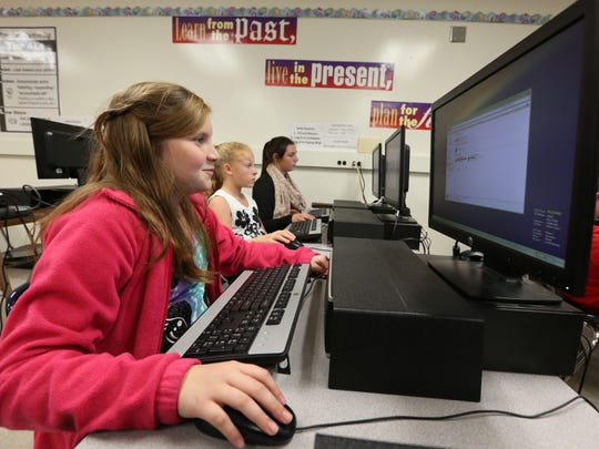 A middle schooler on Des Miones' east side works on a class for her business technology class.