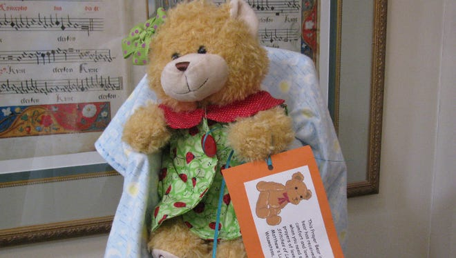 Stitches of Love Quilt Ministry from St. Matthew's Lutheran Church recently distributed 15 teddy bears to the Wauwatosa Fire Department.