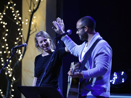 Siri Undlin and Simon Balto perform as Christopher Gold holds his seventh annual toy drive to benefit Harbor House Domestic Abuse Programs Dec. 9 at the OuterEdge in Appleton.