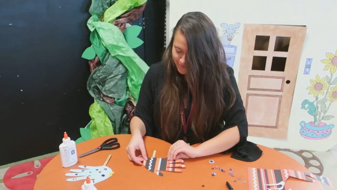Rainea Urbina, youth services librarian at Melissa Public Library, is seen in a screenshot from a video posted on the library's Facebook page demonstrating how to make a fish puppet. The library hosts online craft sessions on Fridays.