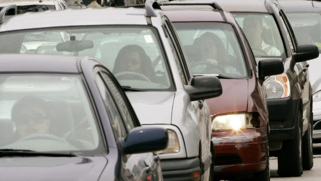 FILE - In this May 15, 2008, file photo, motorists sit in a Chicago traffic jam. More than 800 rear-seat passengers who weren't wearing seat belts were killed in 2018 in U.S. traffic crashes, and states aren't making enough progress in getting people to buckle up, the Governors Highway Safety Association says in a report released Monday, Nov. 18, 2019. (AP Photo/Charles Rex Arbogast, File)